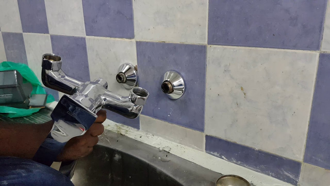 A old kitchen mixer change installed a new mixer in the wall