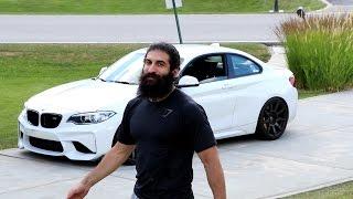 BEARDED MAN DRIVES BMW M2