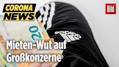 Mieten-Stopp bei Großkonzernen: SPD-Politiker verbrennt Adidas T-Shirt