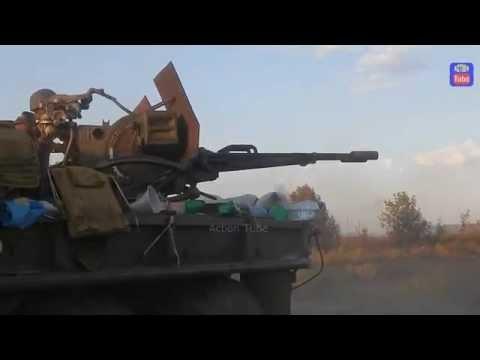 Зенитка бьёт по позициям боевиков. Anti-aircraft gun hits the militant positions