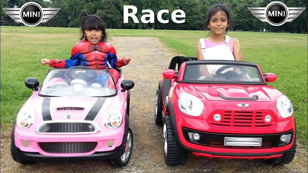 spiderman in pink mini cooper race mini beachcomber in park kids ride on cars playtime challenge