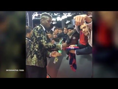 Paul Pogba signs Barcelona shirt at Ballon d'Or ceremony as transfer talk rumbles on