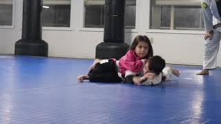 Little girl chokes out boy