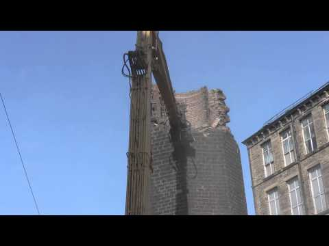 Globe Mill Chimney Demolition with Caterpillar High reach