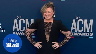 Kelly Clarkson turns heads in a black gown at 2019 ACM Awards