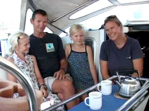 Sailing around the world with family .