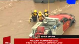 Arizona woman rescued from here minivan during flood