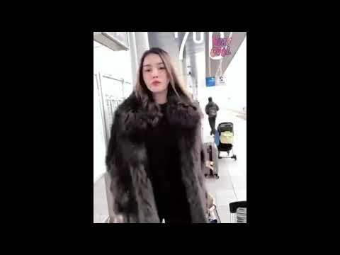 Asian Cute Woman In FUR Coat