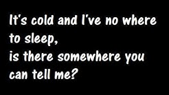Phil Collins Another Day In Paradise Lyrics
