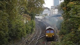 Mostly Freight passing Addison Gardens Bridge, Kensington/Shepherds Bush on 27/10/2016(1. 66148 6V00 Newhaven - Acton 2. Southern Service from Milton Keynes to East Croydon 3. 92038 light loco, 0M92 Dollands Moor to Willesden Traction ..., 2016-10-27T19:44:57.000Z)