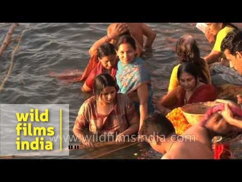Hindu women bathe in