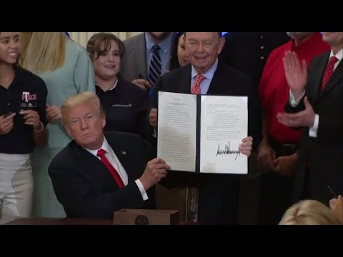 Trump signs executive order aimed at helping American workers