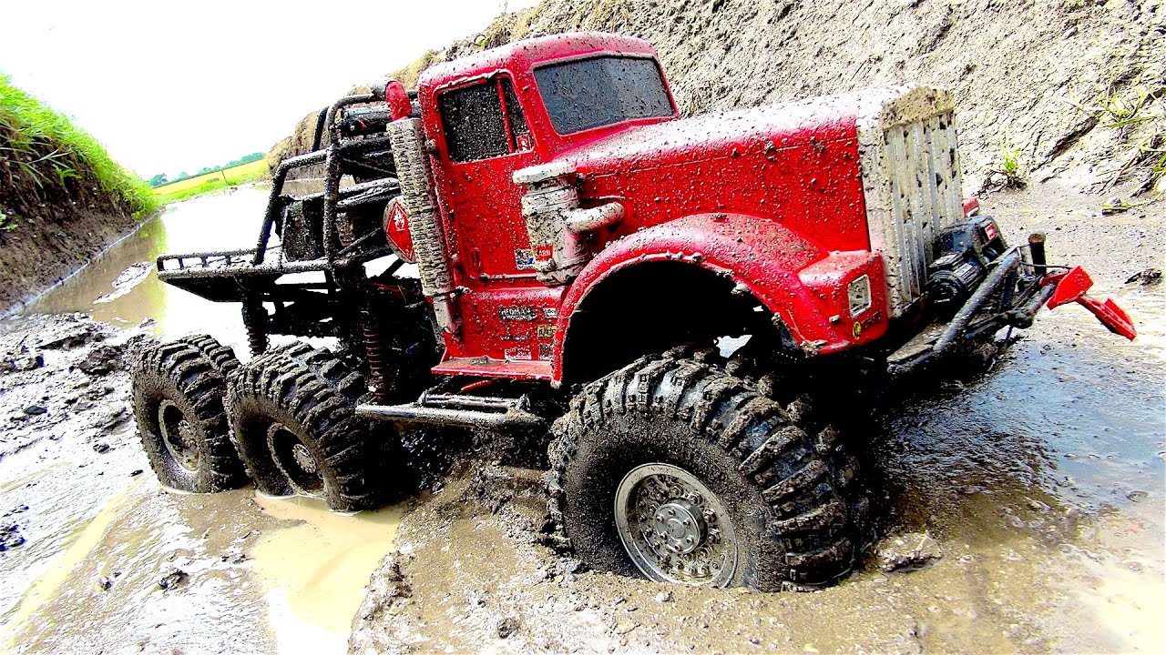 powerful 6x6 truck in muddy swamp off road axle repair. Black Bedroom Furniture Sets. Home Design Ideas