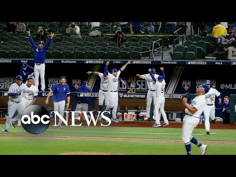 L.A. wins World Series, COVID-19 memorial, Wallace protest: World in Photos, Oct. 28