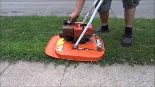 A 1980 Flymo hovering lawnmower Cold start and mowing