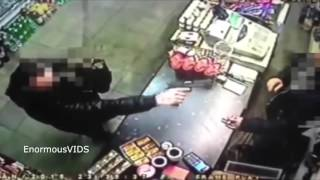 Store Owner Snatches Loaded Gun from Robber