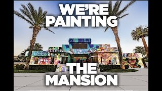 WE ARE SPRAY PAINTING A MANSION.