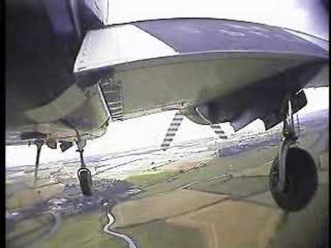 Underneath a PA23 for landing