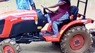 woman driving tractor india kerala