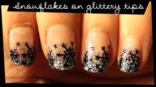 Snowflakes On Glittery Tips Nail Art