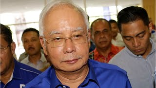 Malaysian Police Raid Apartment Connected To Ousted PM Najib's Family