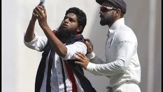virat-fan-click-selfie-with-virat-kohli-on-ground-during-test-match-against-windies-