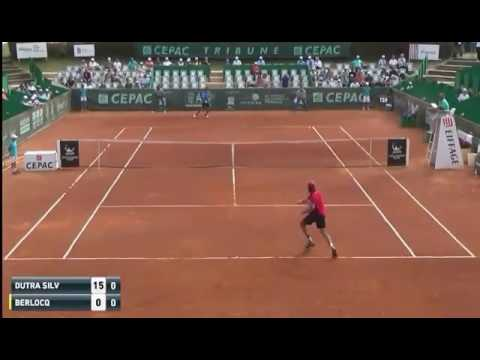 Carlos Berlocq breaks his racket during the second point of the match