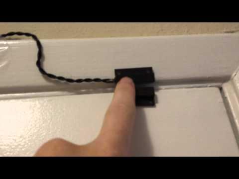 How do alarm system door switches work?
