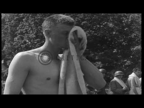 United States soldiers queue to take showers at a base camp in England, prior to...HD Stock Footage