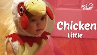 Little Girl In Chicken Costume Kisses Pumpkin