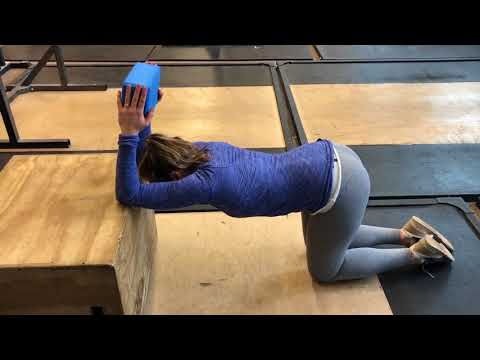 Thoracic Mobility Series: Step 7 Box stretch over yoga wheel