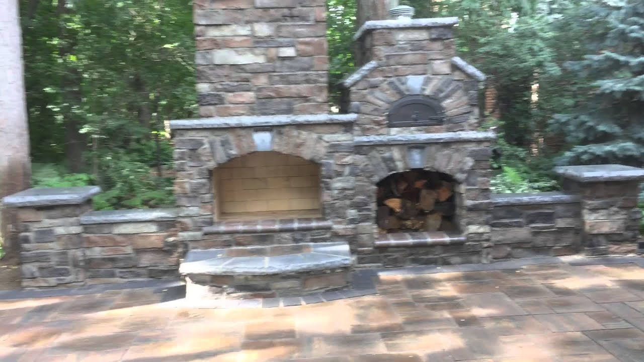 masonry cultured stone side by side pizza oven and fireplace