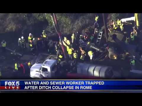 Rome water worker pulled from trench