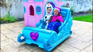 The twins dress up as Elsa and Anna in Frozen Sleigh Ride On