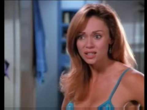 Vanessa Angel in a blue bikini