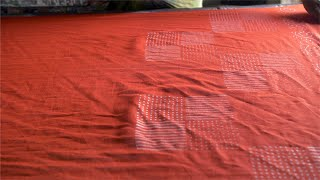 Block Printing - A skilled worker is printing the fabric with blocks