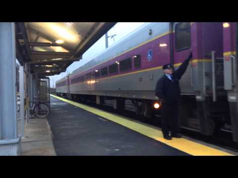 Commuter rail stoping a Westborough station mass.