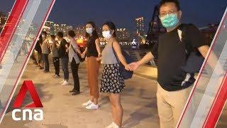Hong Kong protesters form human chain