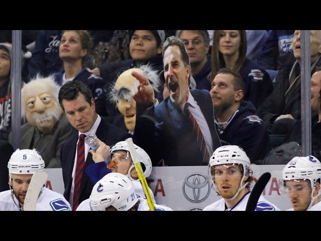 Fan holds funny cut-out of John Tortorella