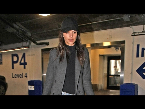 Emily Ratajkowski Keeps A Low Profile At LAX After Her Nude Photos Are Leaked