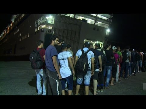 Syrian refugees register on Greek ship docked at Kos