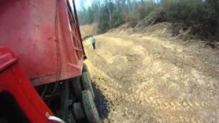 dump truck spreading rocks in reverse