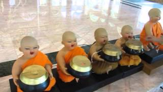 CRAZY BABY MONK electronic money collectors in huge Buddhist temple near Loei
