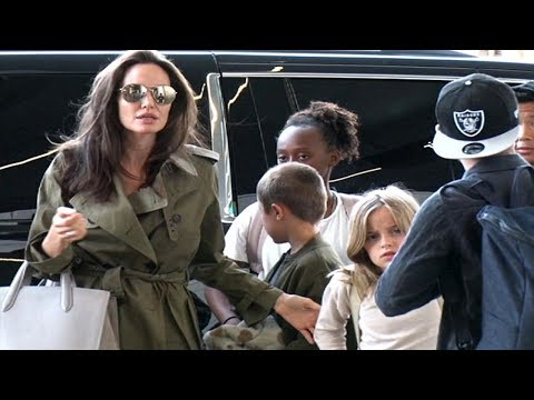 Angelina Jolie jets off with all six kids the day before Father's Day