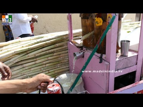 SUGAR CANE JUICE EXTRACTING WITH TRADITIONAL WOOD MACHINE | STREET FOODS IN INDIA