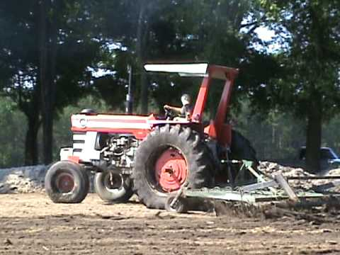 1100  Massey Ferguson pulling Field Cultivator