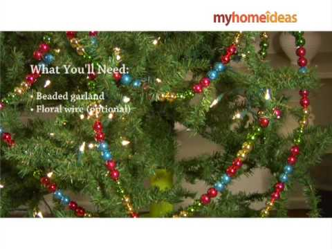 decorating a tree with beaded garland - Beaded Christmas Garland