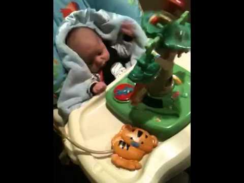 Ashton in his rainforest high chair