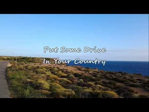 Travis Tritt - Put Some Drive In Your Country (with lyrics)
