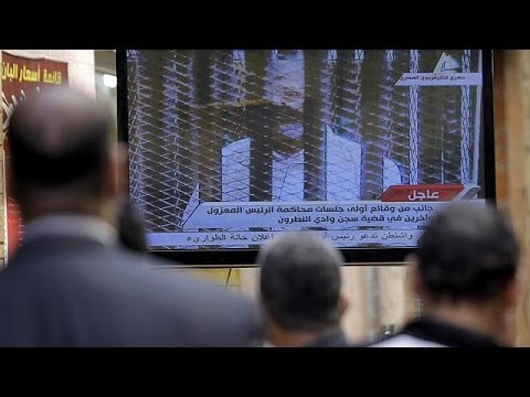 Deadly violence erupts in Cairo as Morsi goes on trial again
